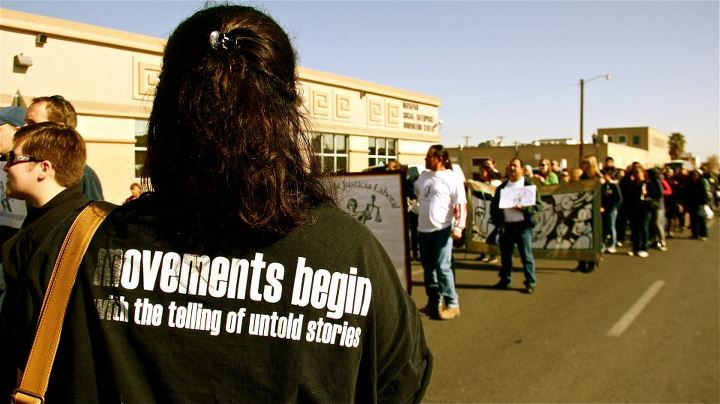 back of shirt reads movments begin with the telling of untold stories